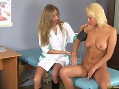 Girl examined and fucked by a medical lesbian