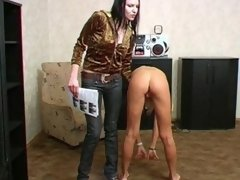 Lesbian trainer drills a nude girl passionately