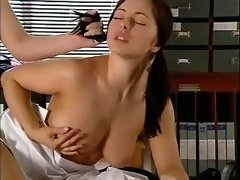 Lady with strapon fucks cute babe on office table